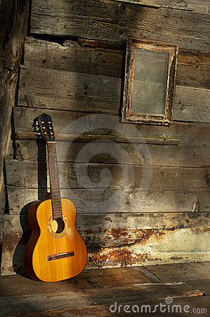 Free Blues Guitar The Old Wooden Wall As Background Royalty Free Stock Photo - 22882515