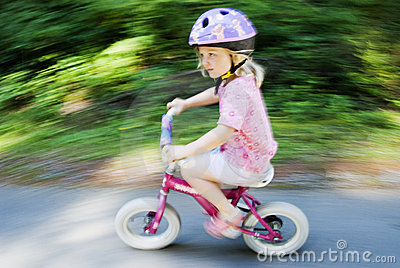 Blur of small child on bike