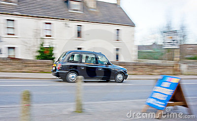 Blurred black cab in Inverness.