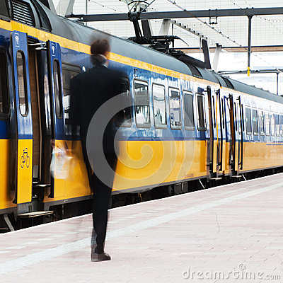 Blurred businessman at the station