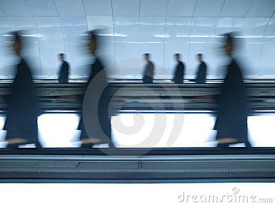 Blurred businessmen go to work