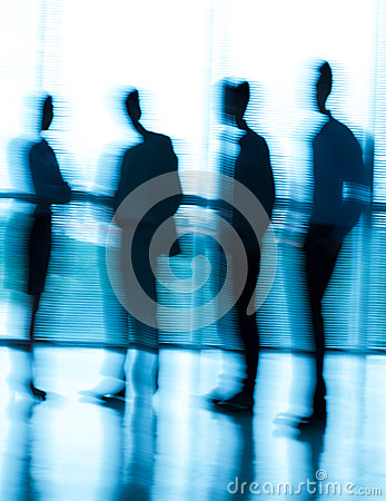 Blurred businesspeople