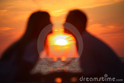 Blurred couple s silhouettes on sunset