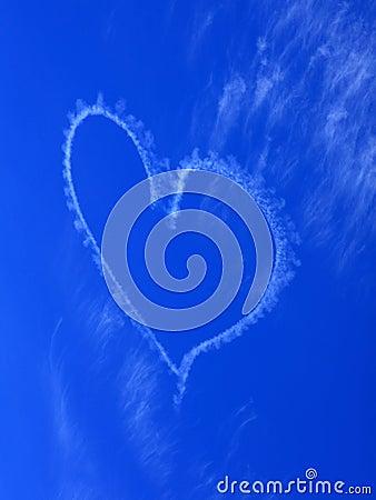 Heart in blue sky blur