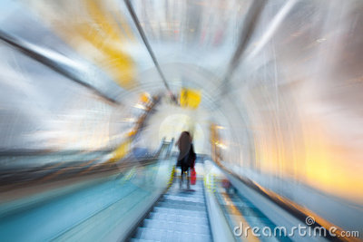 Blurred image of the escalator with a silhouette