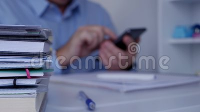 Blurred image interior office with businessman using cellphone communication. Blurred image in interior office with businessman using cellphone communication stock video footage
