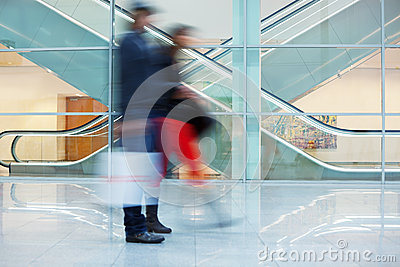 Blurred Image of Young Couple in Office Building