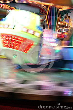 Blurred moving joy ride at carnival