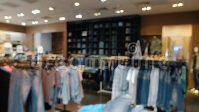 Blurred panorama of denim clothing store in a large shopping center. The concept of high-quality products and high-tech environmentally friendly materials stock video footage