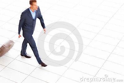 Blurred portrait of young business person walking