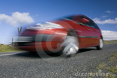 Blurred red car