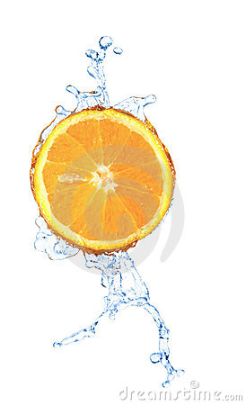 Blurry water splash in a slice of orange  isolated