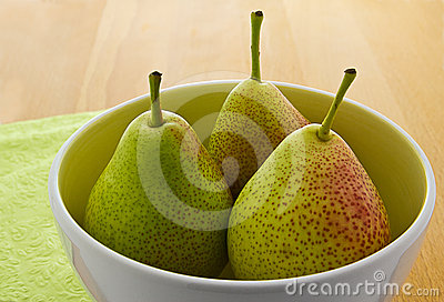 Blushed Forelle pears in white bowl (Pyrus)