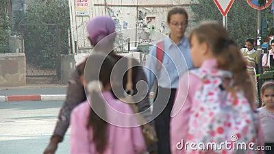Bnei Brak Israel, Circa 2011 - Busy street with orthodox jews walking. Bnei Brak Israel, Circa 2011 - street with orthodox jews walking stock video footage