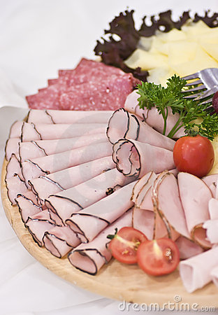 Board of ham and meat slices