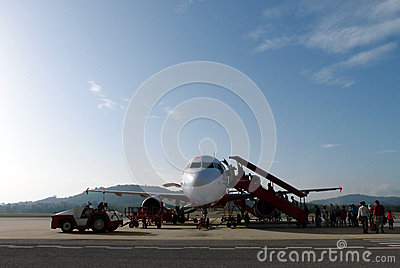 Boarding budget airline plane in rural Asia Editorial Photography