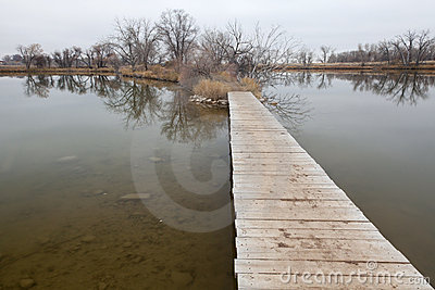 Boardwalk pathway over lake and swamp