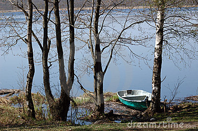 Boat ashore lake