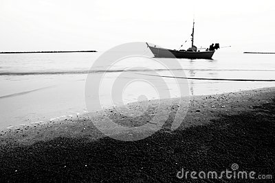 Boat on the beach black and white picture