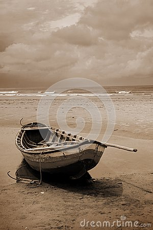 Boat on a beach in sepia