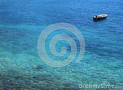Boat in blue ocean