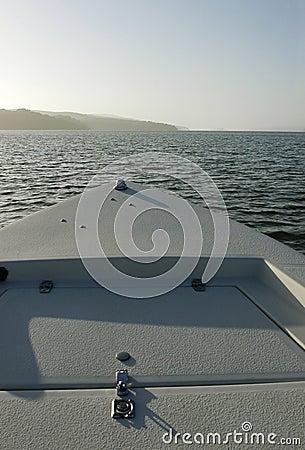 Boat bow toward bay mouth