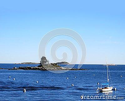 Boat buoys and island seascape