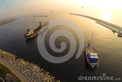 Boat in calm sea at sunset. Aerial Shot.