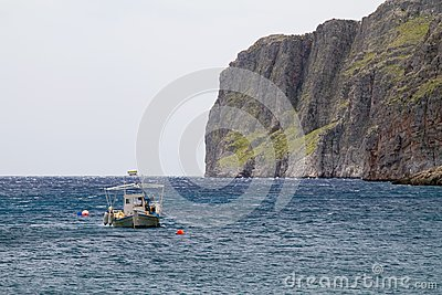 Boat and Cliffs