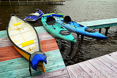 Boat Dock with Canoe and Kayaks