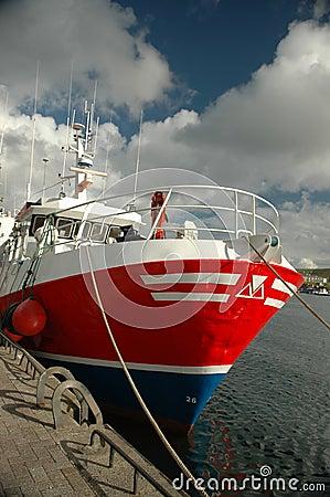 Boat docked at harbor