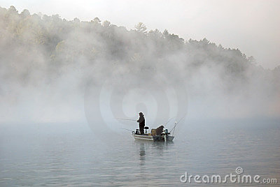 Boat fishing in the fog