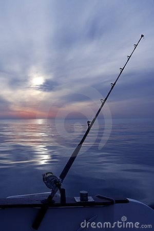 Boat fishing sunrise on mediterranean sea ocean