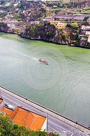 Boat floats on the river Douro,Porto, Portugal