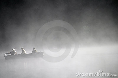 Boat on foggy lake