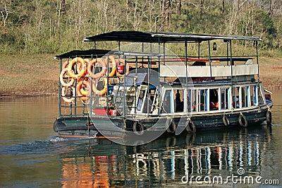 Boat on forest lake, Periyar National Park, Kerala