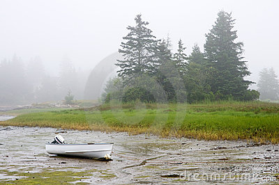 Boat grounded in fog