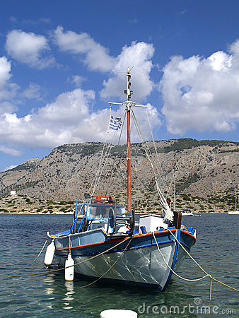 Boat in harbour of Symi