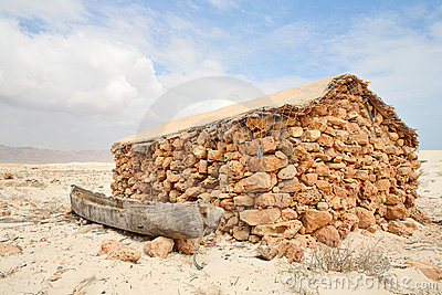 Boat and hut of fisherman on Socotra Island in the