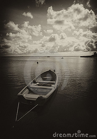 Boat on lake in sepia