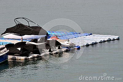 Boat and marine stuff on float platform in harbor