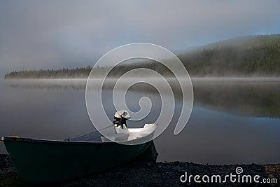 Boat on a misty lake