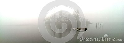Boat on misty lake