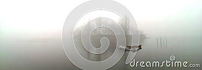 Boat on misty lake