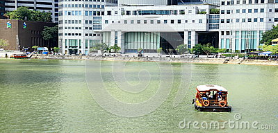 A boat is navigating the singapore river Editorial Photo
