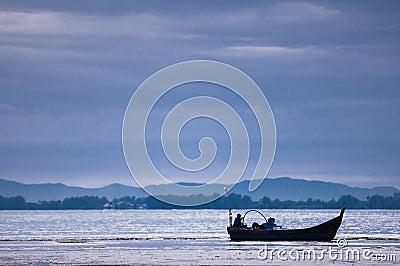 Boat near beach on low tide