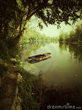 Free Boat On The River Under Green Shadow Royalty Free Stock Photo - 22528235