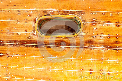Boat oval porthole in wooden hull