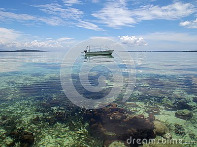Boat over a shallow coral reef
