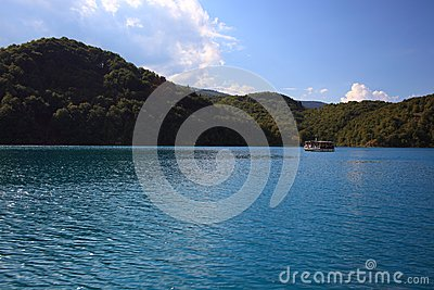 Boat with passengers on a blue lake